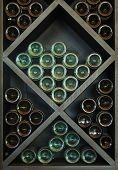 foto of racks  - Wines on Wine Rack bottles stacked on wooden racks - JPG