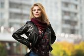 picture of jacket  - Young fashion blond woman in leather jacket on the city street - JPG