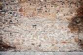stock photo of fortified wall  - Wall of stones and pavement - JPG