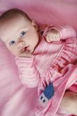 pic of pink eyes  - Little baby girl with short hair and blue eyes - JPG