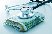 pic of pharmaceutical company  - a stethoscope on a wad of euro bills - JPG