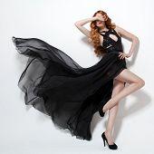 stock photo of flutter  - Fashion woman in fluttering black dress - JPG