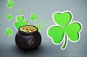 pic of pot gold  - pot of gold against green shamrocks on grey background - JPG