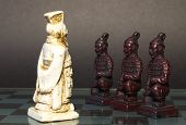 picture of three kings  - Three black pawn on their knees in front of the white king - JPG