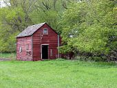 red abandoned weathered farm building
