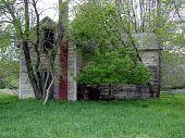 weathered abandoned farm house