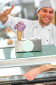 pic of confectioners  - Confectioner selling ice cream in the pastry shop - JPG