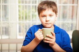 pic of tween  - White tween drinking some coffee from a mug at home - JPG