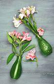 stock photo of jonquils  - Beautiful alstroemeria in vases on wooden background - JPG