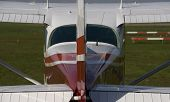 stock photo of cessna  - red cessna on a airport form the back - JPG