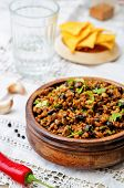 pic of cilantro  - vegetarian chili with cilantro on a dark wood background - JPG