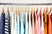 stock photo of racks  - Different clothes on hangers close up - JPG