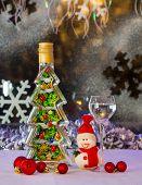 stock photo of vodka  - New Year souvenir bottle of vodka and a Christmas snowman - JPG