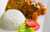 stock photo of curry chicken  - Chicken Curry served with rice - JPG