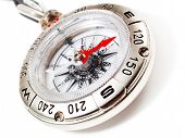 pic of tilt  - Tilted close up view of compass isolated on white background - JPG