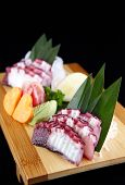 stock photo of octopus  - Sashimi of octopus in a black background - JPG