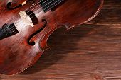 stock photo of cello  - Vintage cello on wooden background - JPG