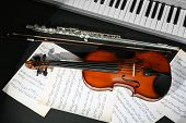 pic of wind instrument  - Musical instruments with music notes on dark background - JPG