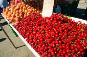 foto of stall  - Cherries and peaches on a street market stall  - JPG
