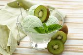 stock photo of mint-green  - fruit creamy ice cream with green kiwi and mint - JPG