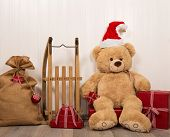 picture of santa sleigh  - Teddy bear as a santa with an old wooden sleigh and red christmas presents - JPG