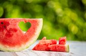 stock photo of watermelon slices  - Watermelon slice with heart shape hole - JPG