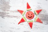 pic of watermelon slices  - slices of watermelon arranged in the shape of the sun - JPG