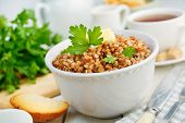 picture of porridge  - Buckwheat porridge with butter and herbs in a white bowl - JPG