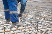 image of reinforcing  - Worker at construction site is preparing reinforcement cage - JPG