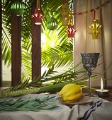 image of holiday symbols  - Symbols of the Jewish holiday Sukkot with palm leaves and candle - JPG