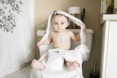 foto of disobedient  - A Toddler ripping up toilet paper in bathroom - JPG
