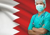 image of bahrain  - Surgeon with flag on background  - JPG