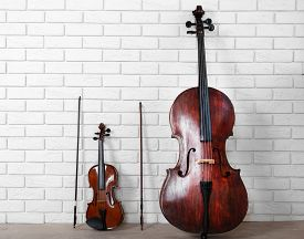picture of cello  - Cello and violin on bricks wall background - JPG