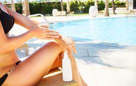 pic of body-lotion  - Woman applying sun cream - JPG