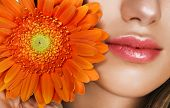 Woman lips and orange flower