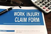 insurance: blank work injury claim form on desk (Form was created for this shooting - no property release necessary)