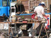 Woman At Flea-Market