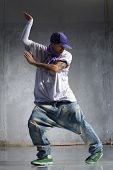 stock photo of gangsta  - cool looking and stylishly dressed dancer posing - JPG