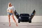 Young blond girl with super car
