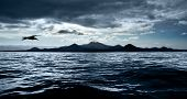 A dark stormy sky over peaceful waters