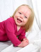 Cute Little Girl Smiling On A White Background poster