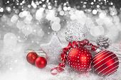 Red Christmas balls over sparkling holiday background. Magic holiday lights. Merry Christmas and a H poster