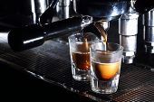 Professional Espresso Machine Brewing A Coffee. Coffee Pouring Into Shot Glasses poster