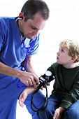 picture of male nurses  - A medical worker taking a young boy - JPG
