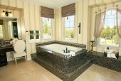 Elegant master bathroom with granite details