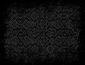 Grungy black floral wallpaper with vignette