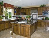Country style kitchen with granite counters and stainless steel appliances