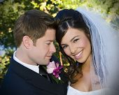 Beautiful bride and loving groom on their wedding day