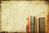 Grungy background with vintage books and copy space