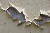 Peeling Paint Off A Grungy Wall